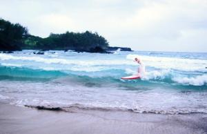 That's my girl, surfing in her wedding dress!